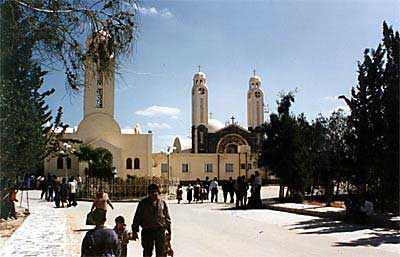Front view of St. Mina Monastery in Mariut showing the church of St. Mina (front left) and the new Cathedral with its two towers (on the right in the back)